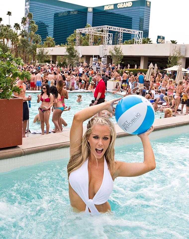 """The former """"Girls Next Door"""" star and Playboy playmate even hopped in the water, where she tossed around a beach ball. (3/24/2012)"""