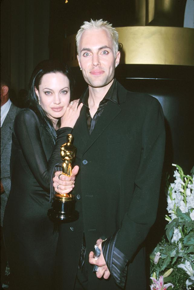 In 2000, Jolie went goth in a black Donatella Versace dress and, after winning the Best Supporting Actress statuette for Girl, Interrupted, sparked some controversy by kissing her brother James in the press room.