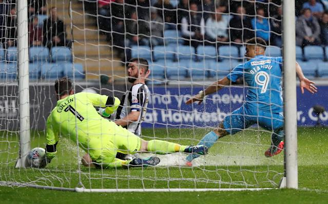 "Soccer Football - League Two Play Off Semi Final First Leg - Coventry City v Notts County - Ricoh Arena, Coventry, Britain - May 12, 2018 Notts County's Adam Collin saves from Coventry's Maxime Biamou Action Images/Andrew Boyers EDITORIAL USE ONLY. No use with unauthorized audio, video, data, fixture lists, club/league logos or ""live"" services. Online in-match use limited to 75 images, no video emulation. No use in betting, games or single club/league/player publications. Please contact your account representative for further details."