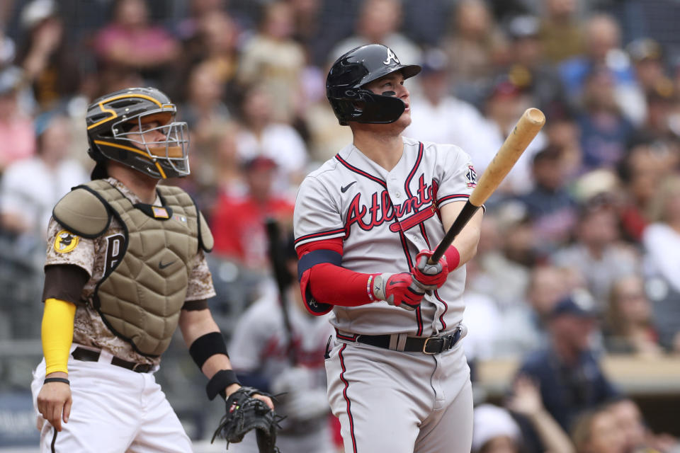 Atlanta Braves' Joc Pederson, right, watches his solo home run as San Diego Padres catcher Victor Caratini looks on in the second inning of a baseball game Sunday, Sept. 26, 2021, in San Diego. (AP Photo/Derrick Tuskan)