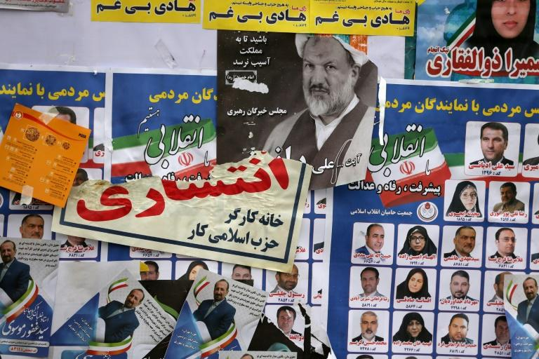 Iranian electoral posters and fliers are pictured on the last day of election campaign in Tehran on February 19
