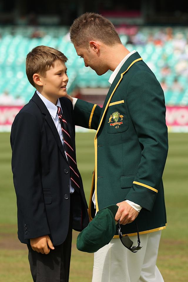 SYDNEY, AUSTRALIA - JANUARY 03:  Australian captain Michael Clarke is presented with the handkerchief of the late Tony Greig by his son Tom Greig during day one of the Third Test match between Australia and Sri Lanka at Sydney Cricket Ground on January 3, 2013 in Sydney, Australia. Tony Greig was a former England test captain turned commentator who died of a heart attack on the 29th of December at age 66.  (Photo by Cameron Spencer/Getty Images)