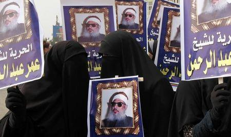 Relatives of Sheikh Omar Abdel-Rahman call for his release before the trial of dozens of democracy activists in Cairo