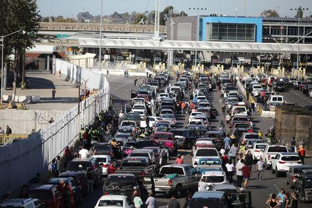 The San Ysidro border crossing between the U.S and Mexico is closed to prevent a caravan of thousands traveling from Central America from crossing in Tijuana