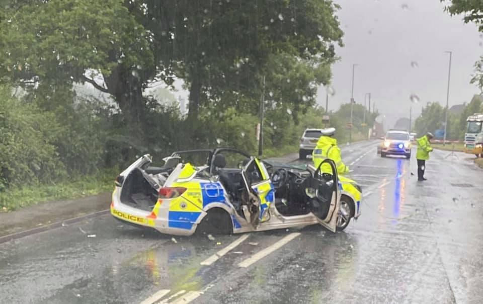 The police car was left completely crushed after the horror crash. (SWNS)