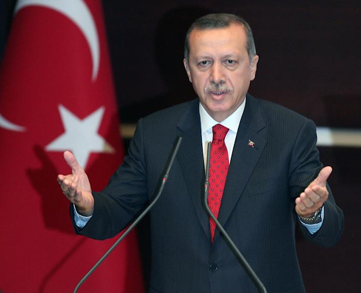 """Turkey's Prime Minister Recep Tayyip Erdigan addresses his party members in Ankara, Turkey, Wednesday, Sept. 5, 2012. Erdogan said Syrian President Bashar Assad's regime is engaged in """"state terrorism"""" an criticized the world for just watching the """"slaughter of Muslims"""" there. Turkey has become the Assad regime's strongest critic and is host to Syrian opposition groups as well as some 80,000 refugees.(AP Photo)"""