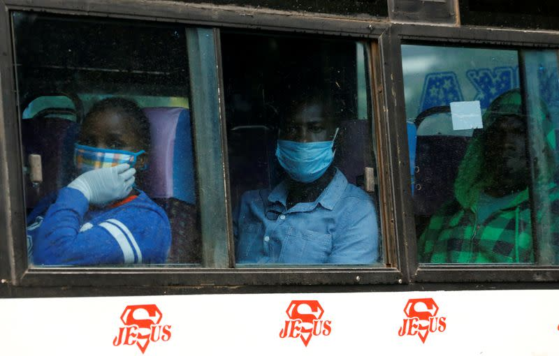 Commuters wear face masks as they ride in a public transportation bus before a curfew as a measure to contain the spread of the coronavirus disease (COVID-19), in downtown Nairobi