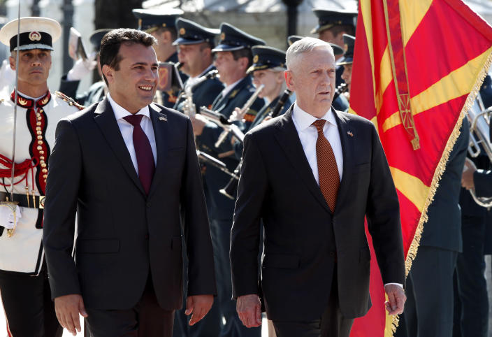 U.S. Defense Secretary James Mattis, right, accompanied by Macedonian Prime Minister Zoran Zaev, left, walks past an honor guard squad upon his arrival at the government building in Skopje, Macedonia, Monday, Sept. 17, 2018. Mattis arrived in Macedonia Monday, condemning Russian efforts to use its money and influence to build opposition to an upcoming vote that could pave the way for the country to join NATO, a move Moscow opposes. (AP Photo/Boris Grdanoski)