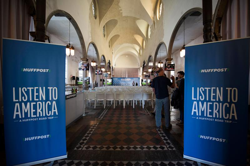 Staffers set up the HuffPost bus tour wrap party at Marigny Opera House.