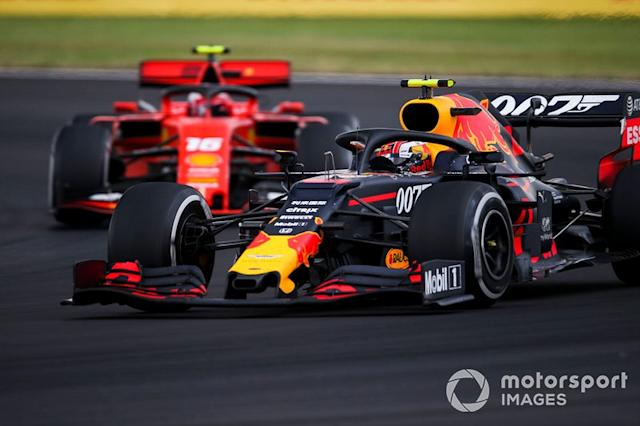 "Pierre Gasly, Red Bull Racing RB15, Charles Leclerc, Ferrari SF90 <span class=""copyright"">Dom Romney / LAT Images</span>"