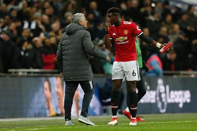 Manchester United's manager Jose Mourinho (L) talks with midfielder Paul Pogba on the sidelines in January 2018 (AFP Photo/Ian KINGTON)