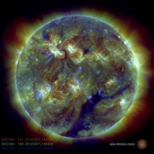 This handout image provided by NASA shows a color-coded image combining observations made by NASA's Solar Dynamics Observatory in several extreme ultraviolet wavelengths, highlighting a bright X-class flare toward the upper left of the sun's disk on March 6
