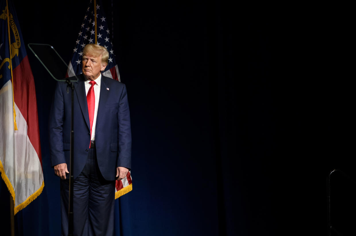 GREENVILLE, NC - JUNE 05: Former U.S. President Donald Trump listens to Laura Trump tell the crowd she has decided not to run for the N.C. Senate at the NCGOP state convention on June 5, 2021 in Greenville, North Carolina. The event is one of former U.S. President Donald Trumps first high-profile public appearances since leaving the White House in January. (Photo by Melissa Sue Gerrits/Getty Images)