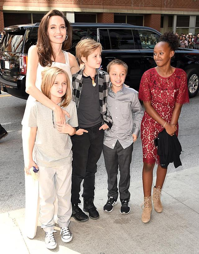 <p>While at the TIFF, Angie and four of her mini-mes — minus Maddox and Pax — attended the premiere of <em>The Breadwinner</em> on Sept. 10. (Photo: J. Merritt/WireImage) </p>