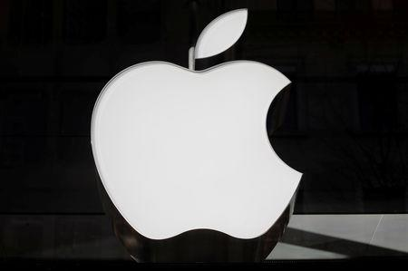 FILE PHOTO: Logo of Apple is seen at a store in Zurich