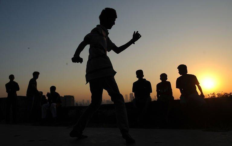 SlumGods members take part in a dance practice at the Sion fort in Mumbai on November 30, 2012. SlumGods now has 40 to 50 core members across the cities of Mumbai, New Delhi and Bangalore