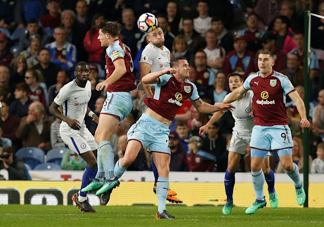 "Soccer Football - Premier League - Burnley vs Chelsea - Turf Moor, Burnley, Britain - April 19, 2018 Chelsea's Gary Cahill in action with Burnley's James Tarkowski and Kevin Long REUTERS/Andrew Yates EDITORIAL USE ONLY. No use with unauthorized audio, video, data, fixture lists, club/league logos or ""live"" services. Online in-match use limited to 75 images, no video emulation. No use in betting, games or single club/league/player publications. Please contact your account representative for further details."