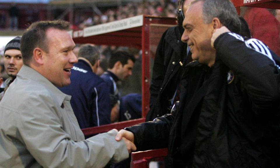Managers Simon Davey and Avram Grant shake hands before the match.
