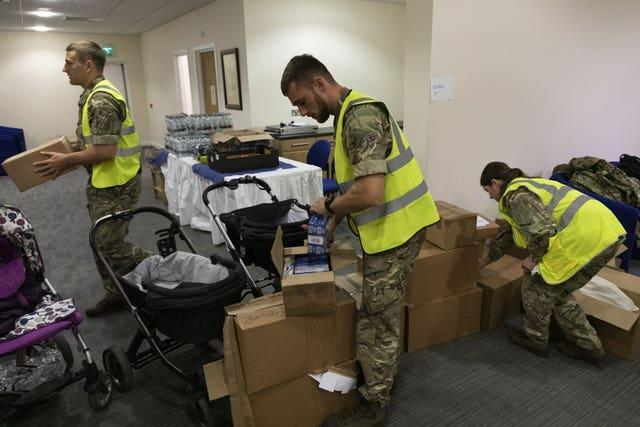 RAF personnel packing necessities for Afghan nationals arriving at RAF Brize Norton