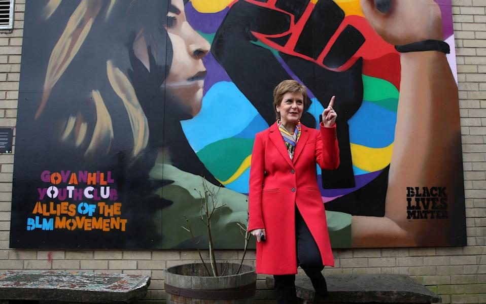 First Minister and leader of the Scottish National Party (SNP) Nicola Sturgeon beside a Black Lives Matters mural in Glasgow - Pool/ Getty Images Europe