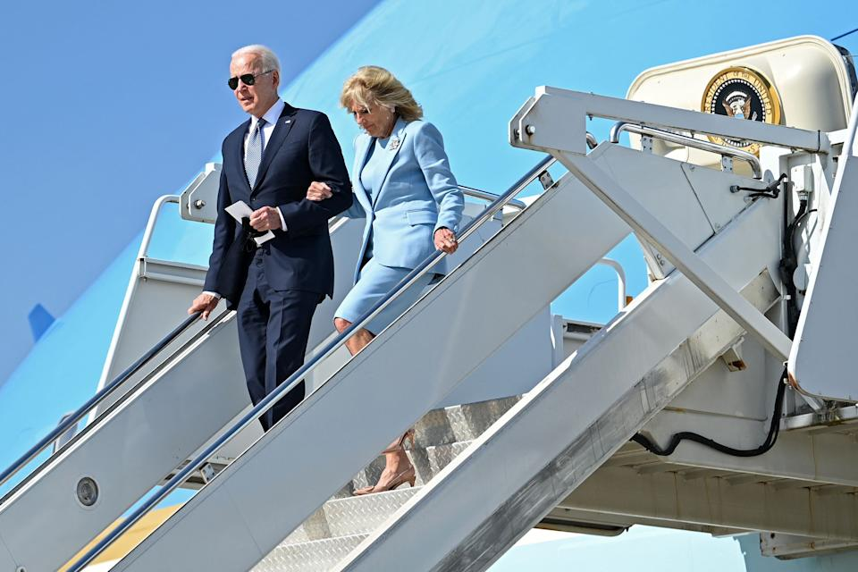 US President Joe Biden and US First Lady Jill Biden disembark from Airforce One at Heathrow, west of London, on June 13, 2021. - US president Biden will visit Windsor Castle late Sunday, where he and First Lady Jill Biden will take tea with the queen. (Photo by Brendan SMIALOWSKI / AFP) (Photo by BRENDAN SMIALOWSKI/AFP via Getty Images)