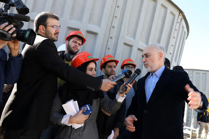 Head of Iran's Atomic Energy Organization Salehi speaks with media during his visit to the nuclear water reactor at Arak