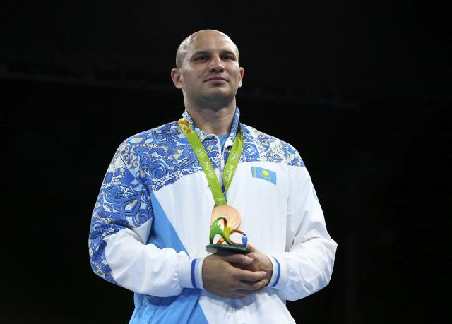 2016 Rio Olympics - Boxing - Victory Ceremony - Men's Super Heavy (+91kg) Victory Ceremony - Riocentro - Pavilion 6 - Rio de Janeiro, Brazil - 21/08/2016. Bronze medallist Ivan Dychko (KAZ) of Kazakhstan poses with his medal. REUTERS/Peter Cziborra FOR EDITORIAL USE ONLY. NOT FOR SALE FOR MARKETING OR ADVERTISING CAMPAIGNS.