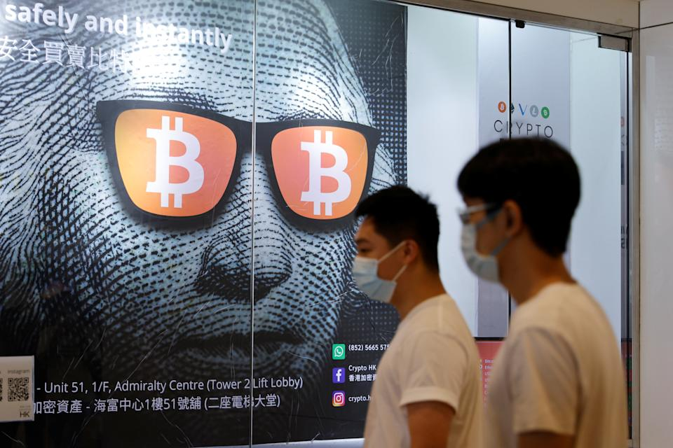An advertisement for Bitcoin and cryptocurrencies is seen in Hong Kong, China September 27, 2021. REUTERS/Tyrone Siu