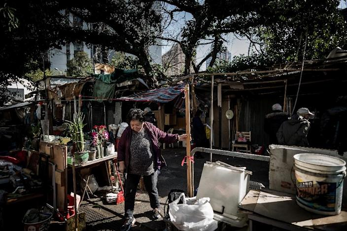 While many walled villages still remain intact on Hong Kong's rural outskirts, Nga Tsin Wai is the only one left in the heart of the city (AFP Photo/Philippe Lopez)
