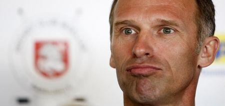 Dominik Hasek addresses a press conference in Prague