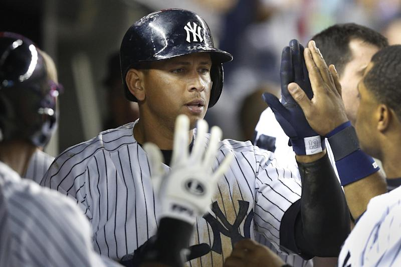 New York Yankees's Alex Rodriguez (13) celebrates with his teammates in the dugout after scoring in the the eighth inning of a baseball game against the Chicago White Sox at Yankee Stadium, Tuesday, Sept. 3, 2013, in New York. The Yankees defeated the White Sox, 6-4. (AP Photo/John Minchillo)