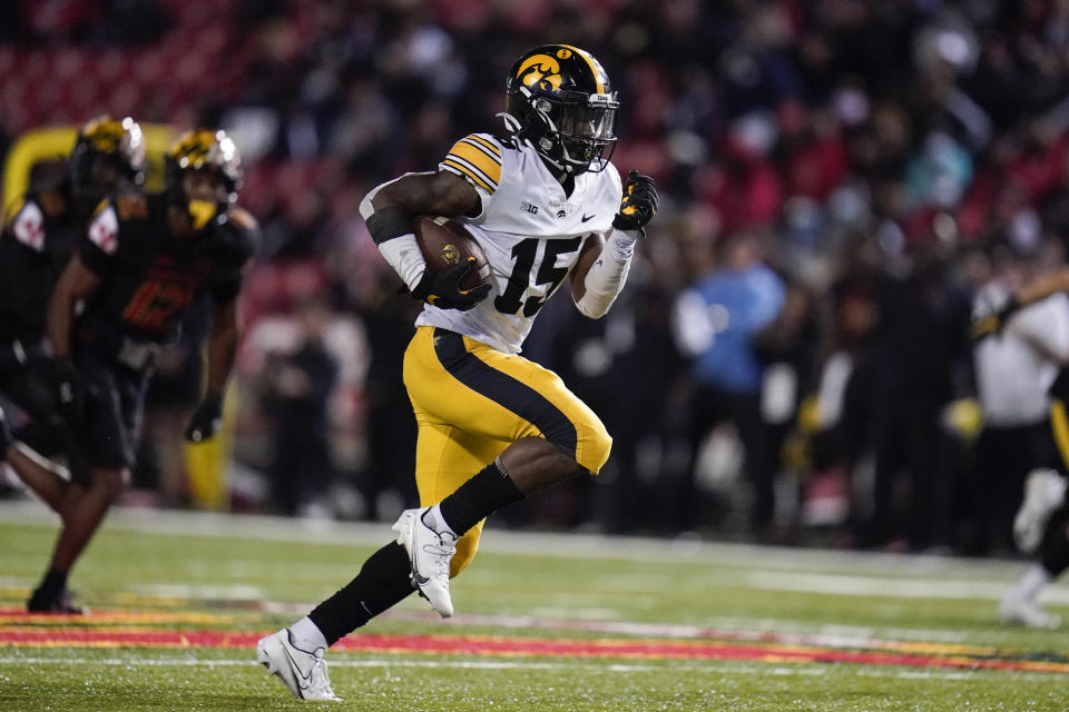 Iowa running back Tyler Goodson runs for a long touchdown against Maryland during the second half of an NCAA college football game, Friday, Oct. 1, 2021, in College Park, Md. (AP Photo/Julio Cortez)