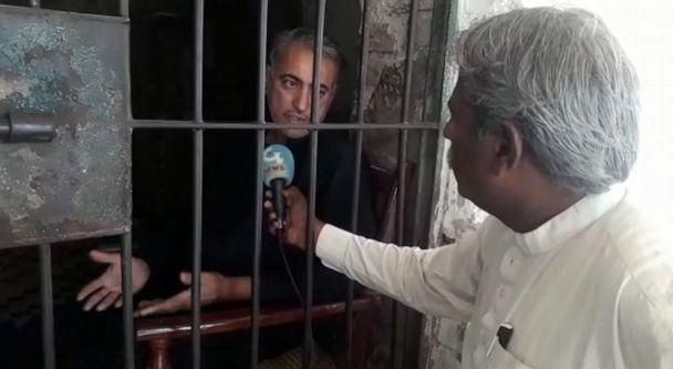 PHOTO: Muzaffar Ghanghro, a physician accused of allegedly knowingly spreading HIV, speaks to journalist Muhammad Yousaf Shaikh, in Larkana, Pakistan, in May 2019. (Muhammad Yousaf Shaikh)