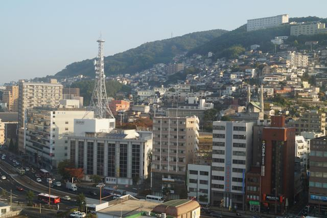 <p>A view of hilly Nagasaki neighborhoods from Nagasaki Station. (Photo: Michael Walsh/Yahoo News) </p>