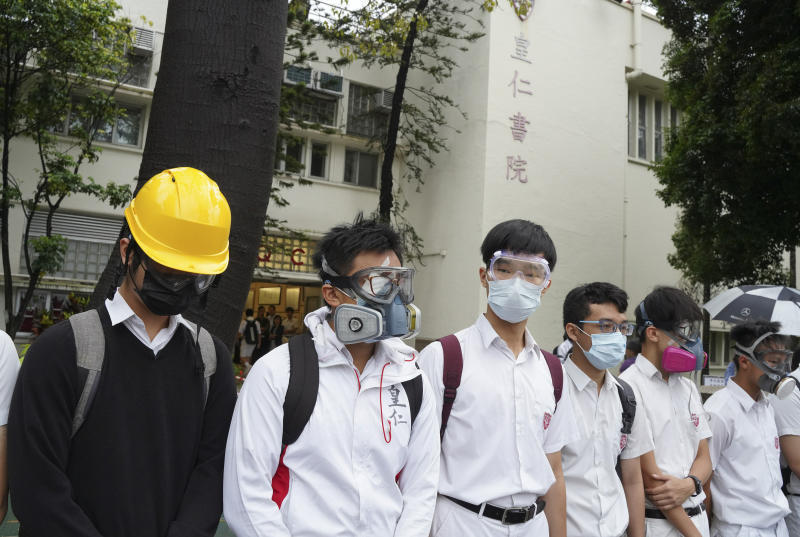 Students wearing gas masks and helmets gather outside Queen's College during a protests in Hong Kong, on Monday, Sept. 2, 2019. Hong Kong has been the scene of tense anti-government protests for nearly three months. The demonstrations began in response to a proposed extradition law and have expanded to include other grievances and demands for democracy in the semiautonomous Chinese territory. (AP Photo)