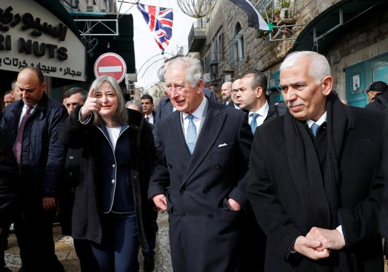 Britain's Prince Charles arrives to visit Omar mosque in Bethlehem in the Israeli-occupied West Bank