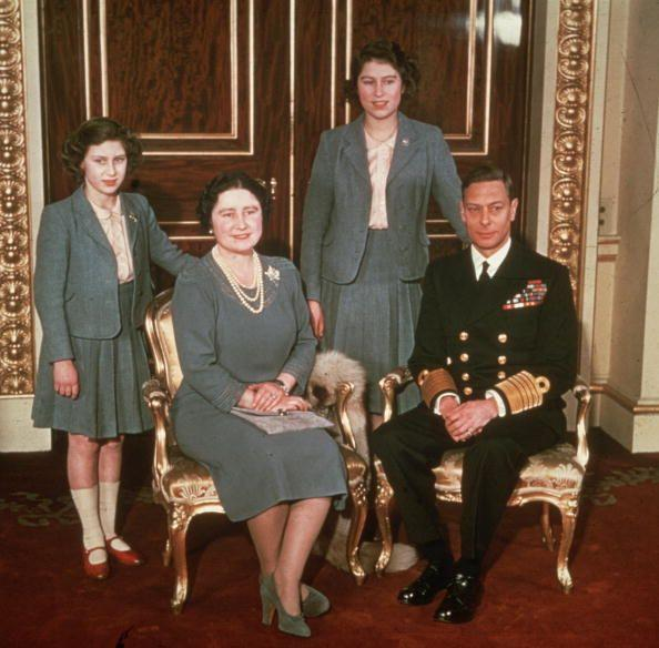 <p>The King and Queen pose with Princesses Margaret and Elizabeth. This year, tragedy hits when Prince George, Duke of Kent (King George's brother) is killed in active service only weeks after his son Michael is born. </p>