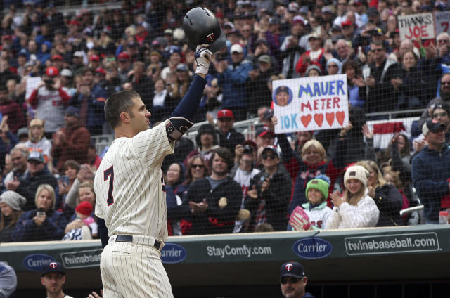 Minnesota Twins' Joe Mauer, the subject of retirement talk, acknowledges a standing ovation before batting against the Chicago White Sox in the first inning of a baseball game Sunday, Sept. 30, 2018, in Minneapolis. (AP Photo/Jim Mone)