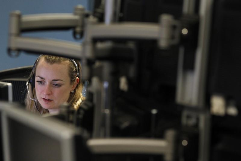 A trader monitors her screen on a trading floor in London January 22, 2010. REUTERS/Stefan Wermuth/Files