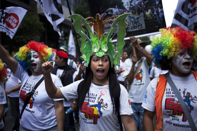 People protest during a march in Rio de Janeiro, Brazil, Monday, Nov. 26, 2012.  Thousands of demonstrators gathered in downtown Rio de Janeiro for a march against legislation that officials here insist would strip this oil-producing state of much of its income from the energy sector. The protesters are calling on President Dilma Rousseff to veto the measure. (AP Photo/Victor R. Caivano)