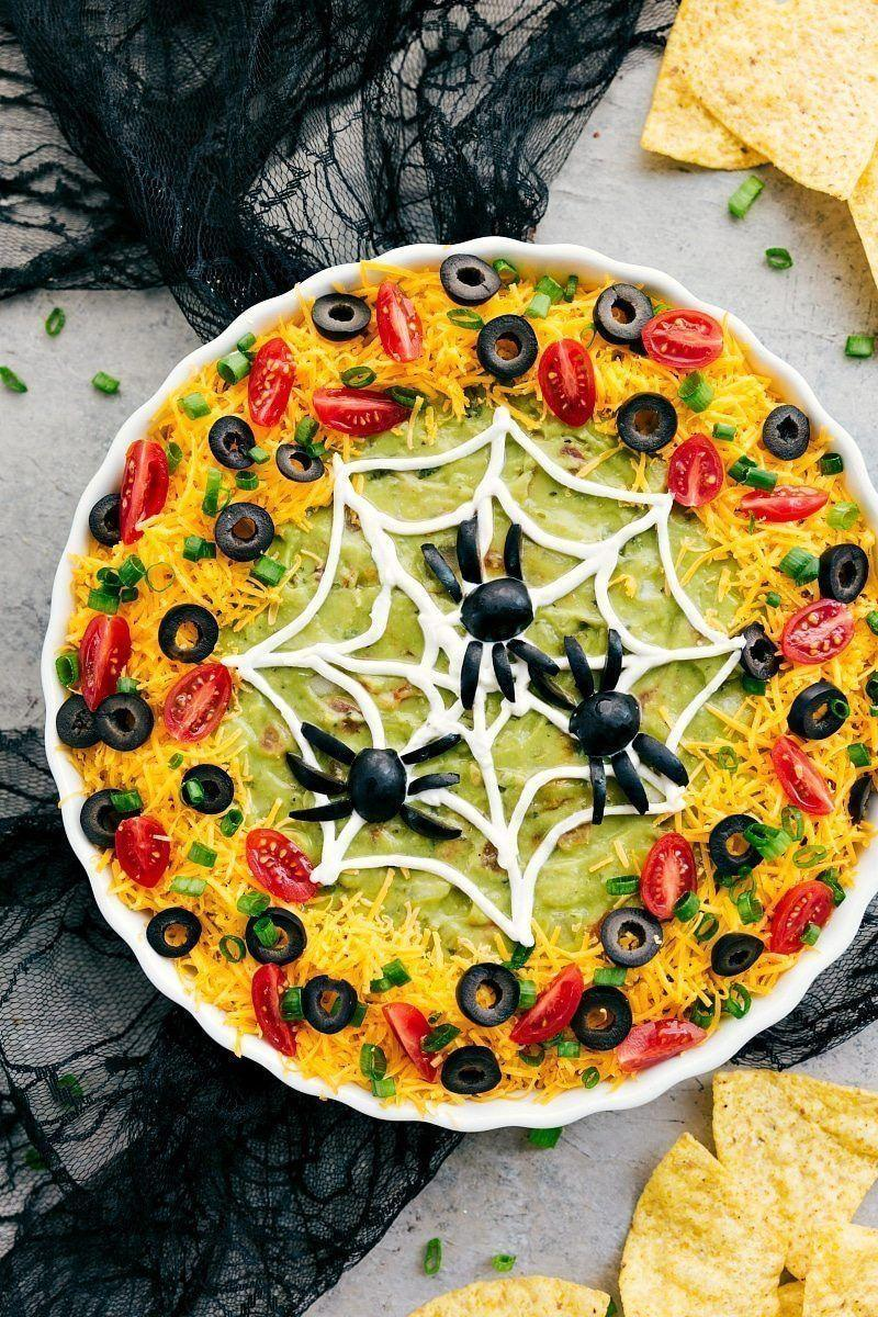 "<p>Refried beans, guacamole, and plenty of cheese are the basis for a party fave that's arranged in this attractive spider-y design. </p><p><a class=""link rapid-noclick-resp"" href=""https://www.chelseasmessyapron.com/halloween-appetizers/"" rel=""nofollow noopener"" target=""_blank"" data-ylk=""slk:GET THE RECIPE"">GET THE RECIPE</a></p>"