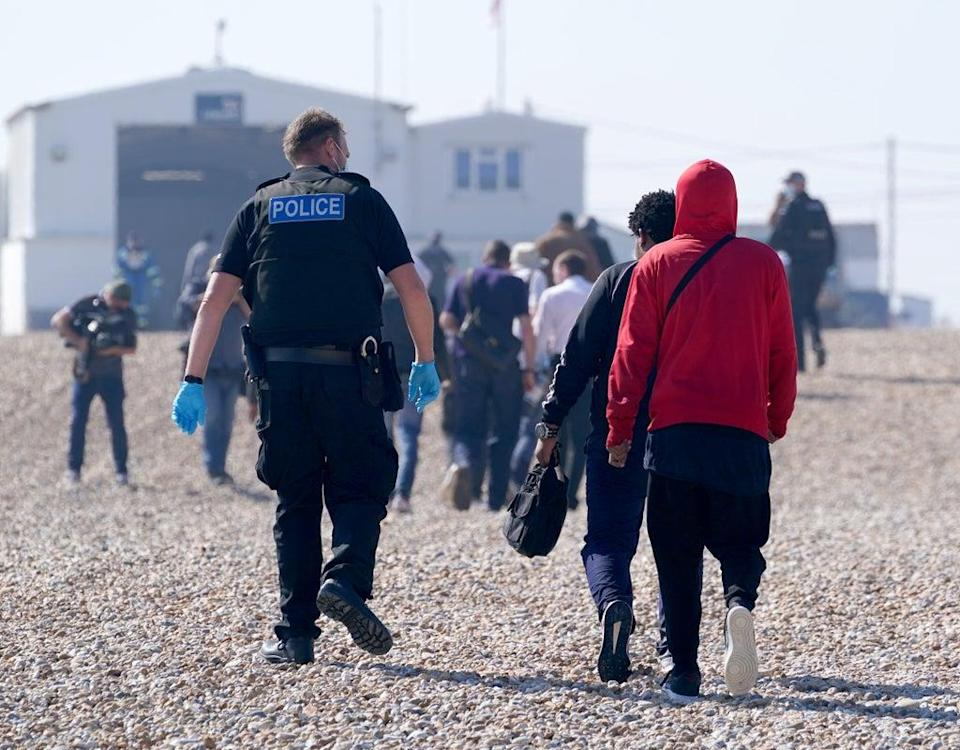 A group of people thought to be migrants are brought ashore from the Dungeness lifeboat in Kent (Gareth Fuller/PA) (PA Wire)