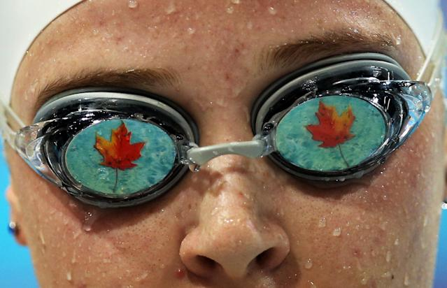 LONDON, ENGLAND - AUGUST 31: Visually impaired swimmer, Amber Thomas of Canada competes in the Women's 100m Freestyle on day two of the London 2012 Paraympic Games at the Aquatics Centre on August 31, 2012 in London, England. (Photo by Ian MacNicol/Getty Images)