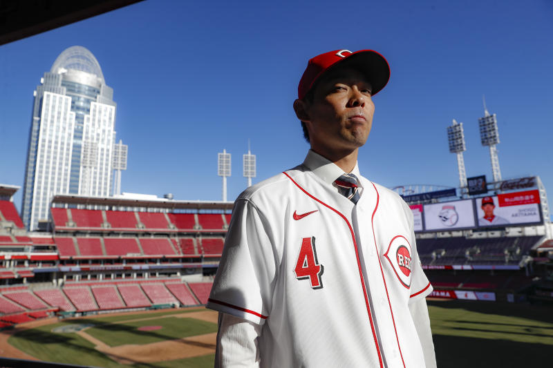 Cincinnati Reds outfielder Shogo Akiyama stands for photographs at Great American Ballpark after a news conference, Wednesday, Jan. 8, 2020, in Cincinnati. Outfielder Shogo Akiyama agreed to a $21 million, three-year deal with the Cincinnati Reds, the only major league baseball team that hasn't had a player born in Japan. The 31-year-old center fielder was a five-time All-Star during his nine seasons with the Seibu Lions in Japan's Pacific League. (AP Photo/John Minchillo)