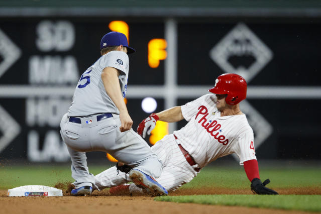 Philadelphia Phillies' Scott Kingery, right, cannot steal second base past the tag from Los Angeles Dodgers shortstop Corey Seager during the third inning of a baseball game Wednesday, July 17, 2019, in Philadelphia. (AP Photo/Matt Slocum)