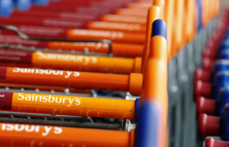 FILE PHOTO - Shopping trolleys are lined up in front of a Sainsury's supermarket in London