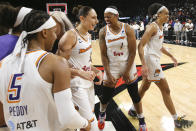 Phoenix Mercury guard Diana Taurasi (3) celebrates with teammates after they defeated the Las Vegas Aces 87-84 in Game 5 of a WNBA basketball playoff series Friday, Oct. 8, 2021, in Las Vegas. (AP Photo/Chase Stevens)