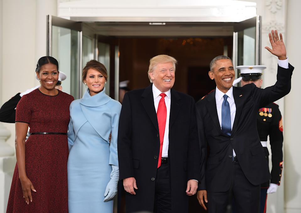 US President Barack Obama(R) and First Lady Michelle Obama(L) welcome President-elect Donald Trump(2nd-R) and his wife Melania to the White House in Washington, DC January 20, 2017.