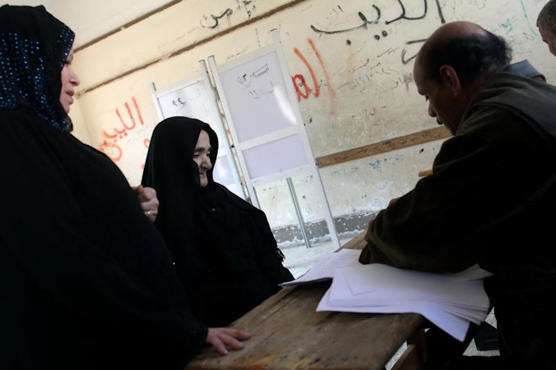 "Christian voters check in before casting their ballots in the constitutional referendum inside a polling station in Dalga village of Minya, Egypt, Wednesday, Jan. 15, 2014. Through violence or intimidation, Islamists in villages like this one used violence or intimidation to stop Christians from voting ""no"" to a 2012 constitution that had paved the way for the creation of an Islamic state. This time around, no one is stopping the Christians and they are voting ""yes"" on a new charter that criminalizes discrimination and instructs the next legislature to ease restrictions on building churches. (AP Photo/Roger Anis, El Shorouk Newspaper) EGYPT OUT"