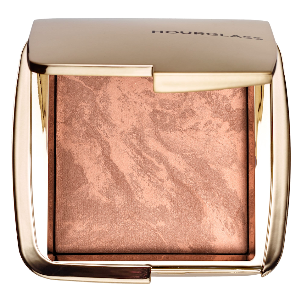 """This powder is very neutral, so it never reads orange—making it a great natural bronzer for fair skin. However, the real selling point that makes it worth its $52 price tag is its luminous finish. The bronzer is formulated using what the brand calls """"photoluminescent technology,"""" which essentially means it reflects light to blur your skin and add a lit-from-within glow. While some powders can look flat, because this one is so finely milled and has light-reflecting particles, it actually makes skin look dewier—but definitely not sparkly. $52, Hourglass Ambient Lighting Bronzer in Nude Bronze Light. <a href=""""https://www.sephora.com/product/ambient-bronzer-P395697?skuId=1944628"""" rel=""""nofollow noopener"""" target=""""_blank"""" data-ylk=""""slk:Get it now!"""" class=""""link rapid-noclick-resp"""">Get it now!</a>"""